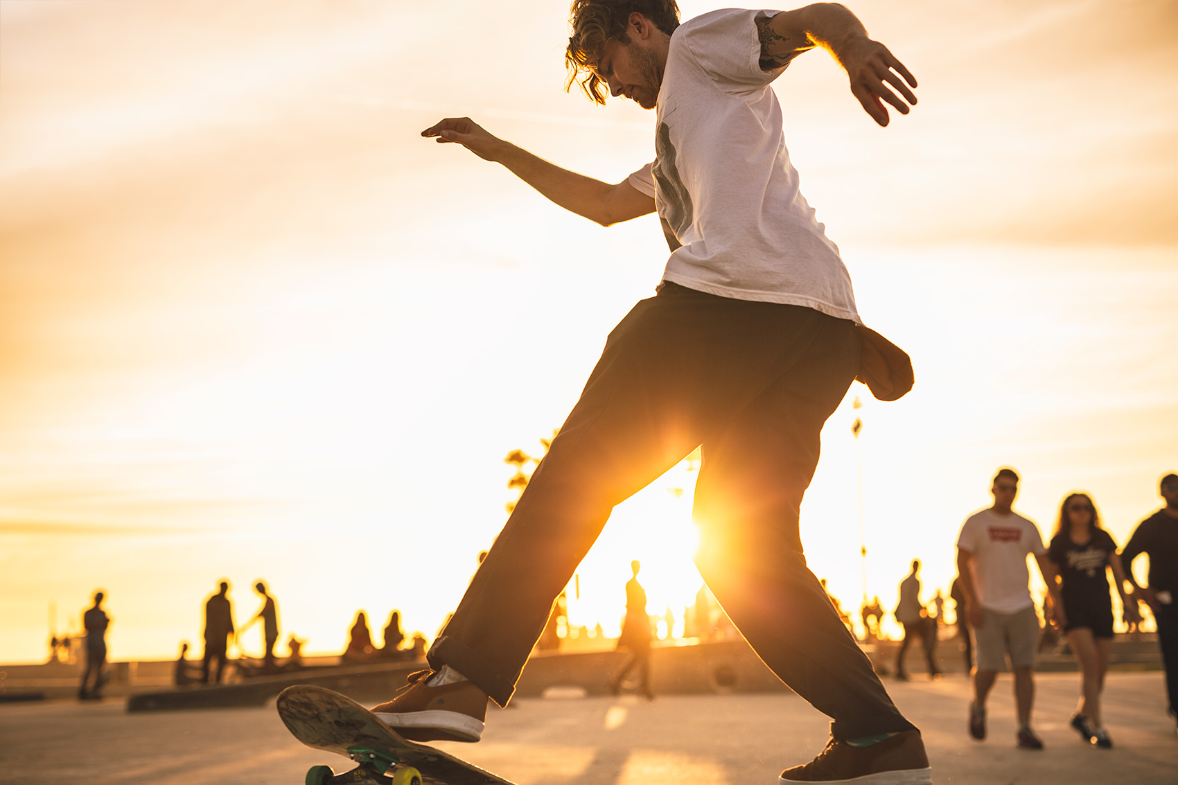 Venice Boardwalk and Skateboarder at Sunset